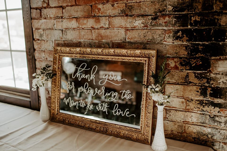 Antique gold sign: Modern Greenery Baby Shower at Maggie's on the River featured on Pretty Little Vintage Co.