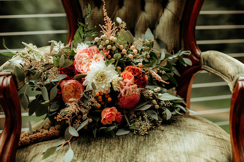 Orange and white wedding bouquet: Warm Toned Backyard Wedding on Skaneateles Lake in Spafford, NY featured on Pretty Little Vintage Co.