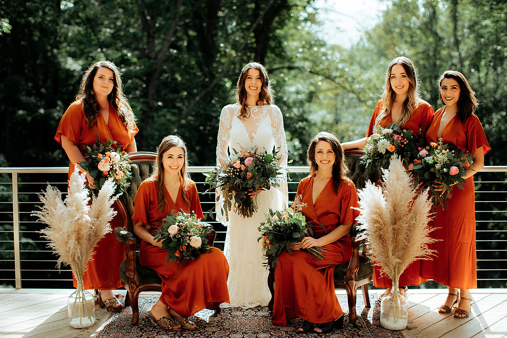 Burnt Orange Bridesmaids Dresses: Warm Toned Backyard Wedding on Skaneateles Lake in Spafford, NY featured on Pretty Little Vintage Co.