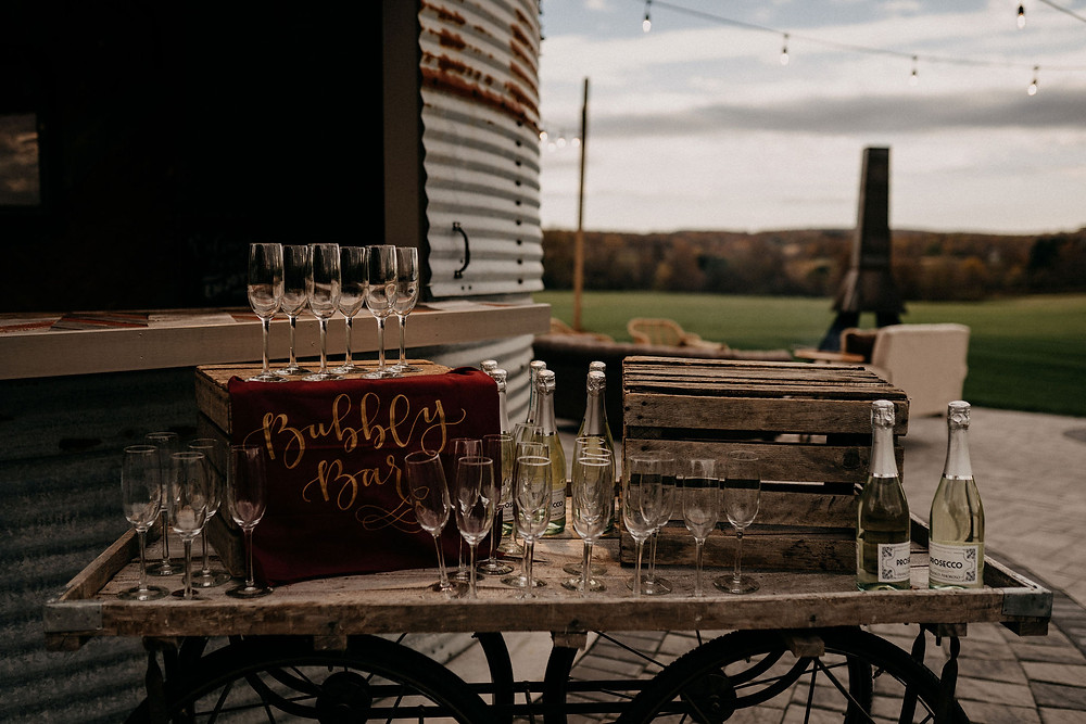 Wedding Champagne Bar: Warm & Rustic Styled Shoot at Hayloft in the Arch captured by Tracy Jade Photography featured on Pretty Little Vintage Co.