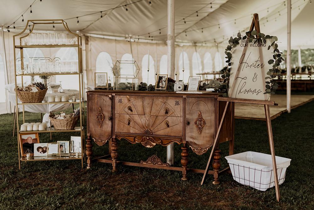 Wedding reception entrance with vintage wedding decor