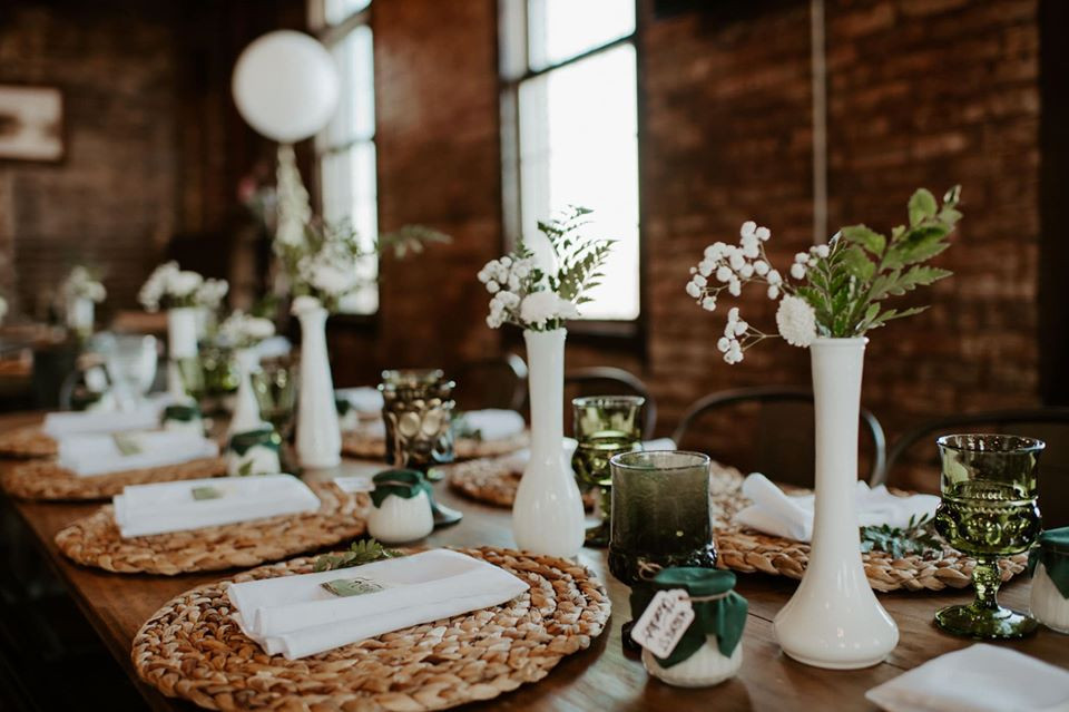 Milk glass centerpieces: Modern Greenery Baby Shower at Maggie's on the River featured on Pretty Little Vintage Co.