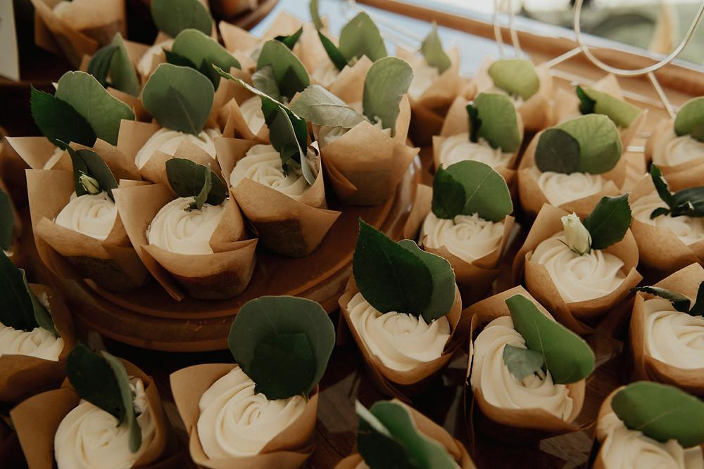 White icing wedding cupcake with eucalyptus