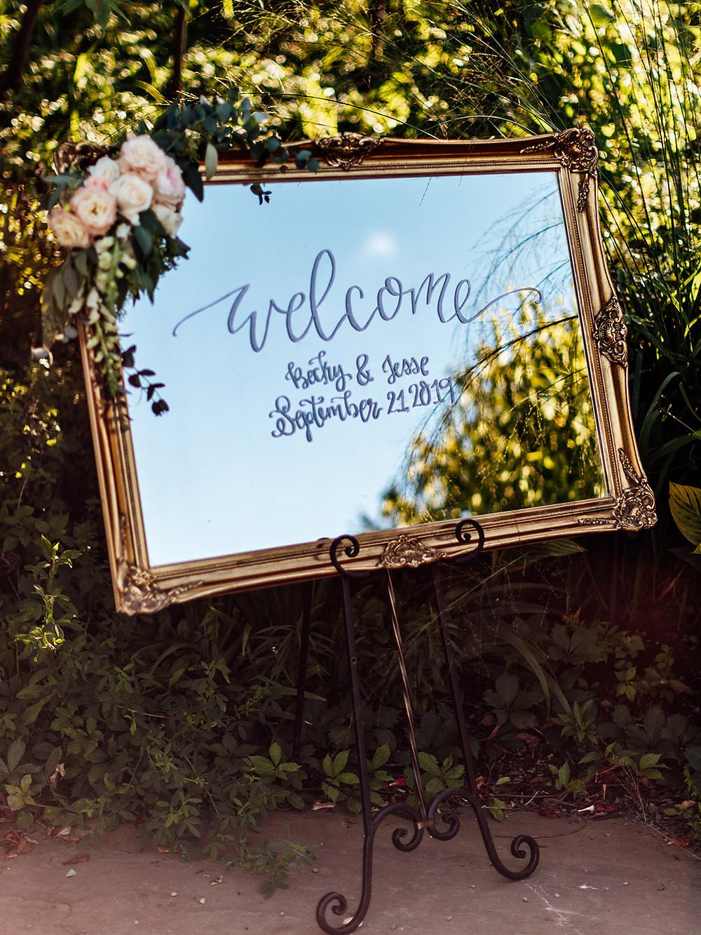 Antique gold mirror wedding welcome sign; Vintage Glam Barn Wedding at The Treman Center