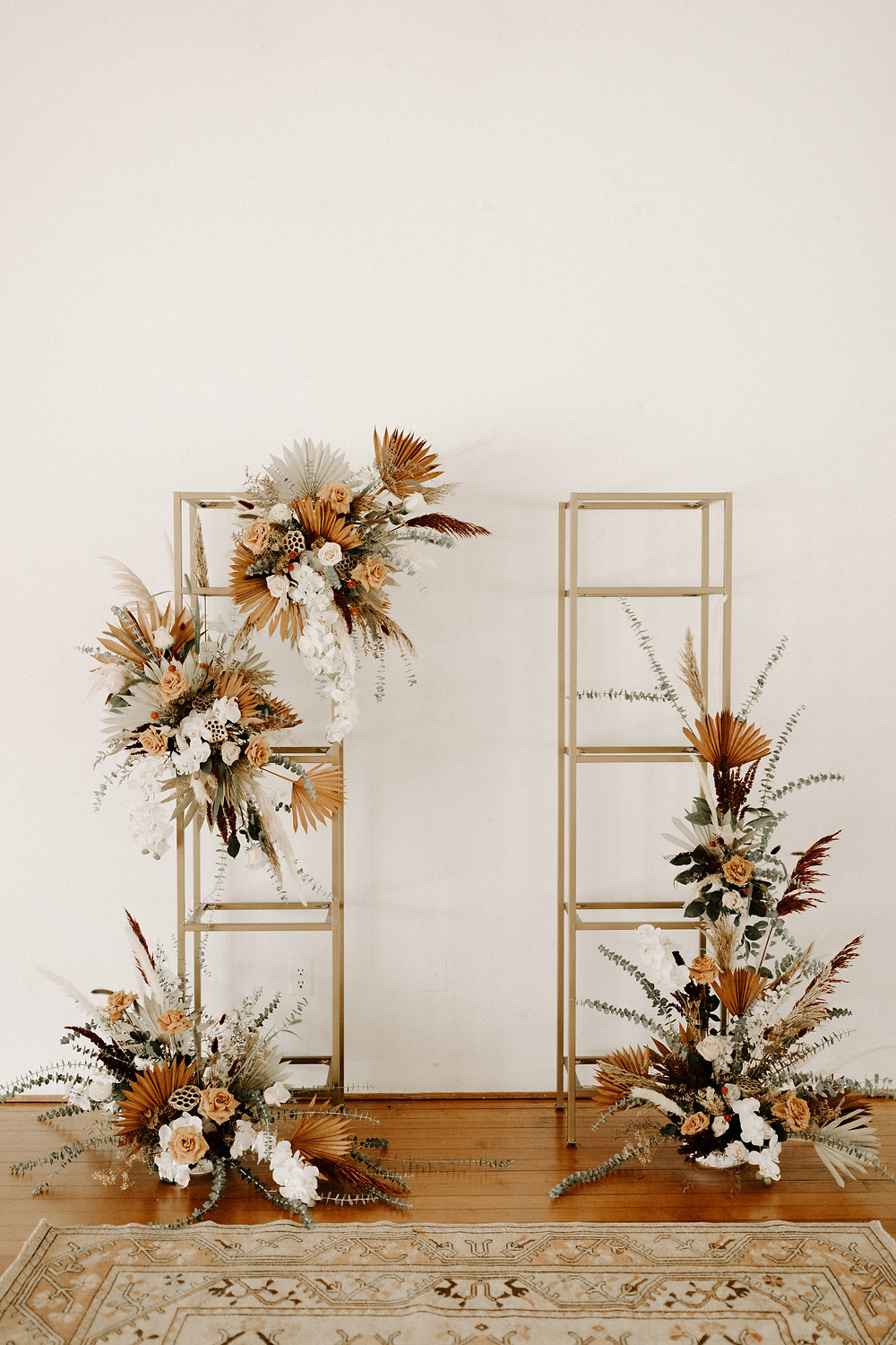 Gold glass shelves with large flowers wedding decor
