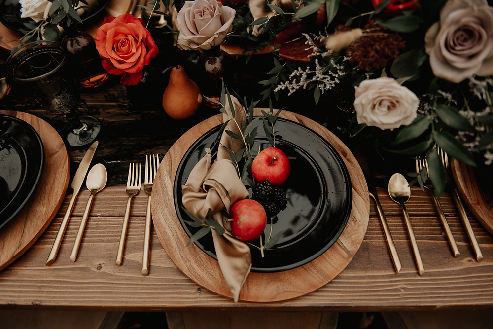 Wood wedding chargers with black plates: Dark & Romantic Wedding Inspiration featured on Pretty Little Vintage Co.