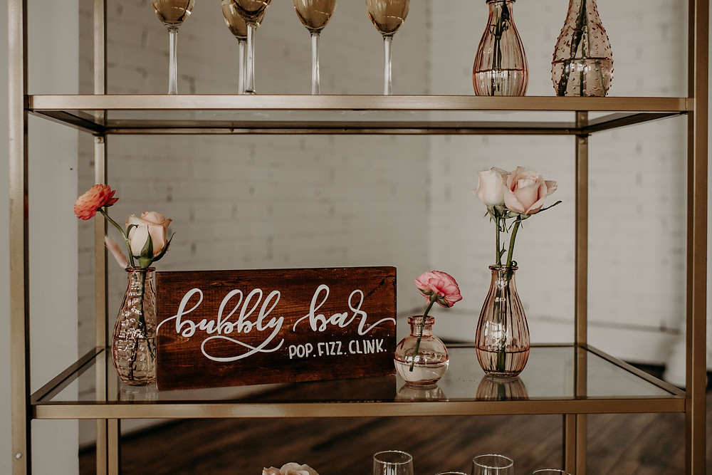 Hand-lettered wooden champagne bar sign: Citrus Colored Baby Shower Inspiration with Pretty Little Vintage Co.