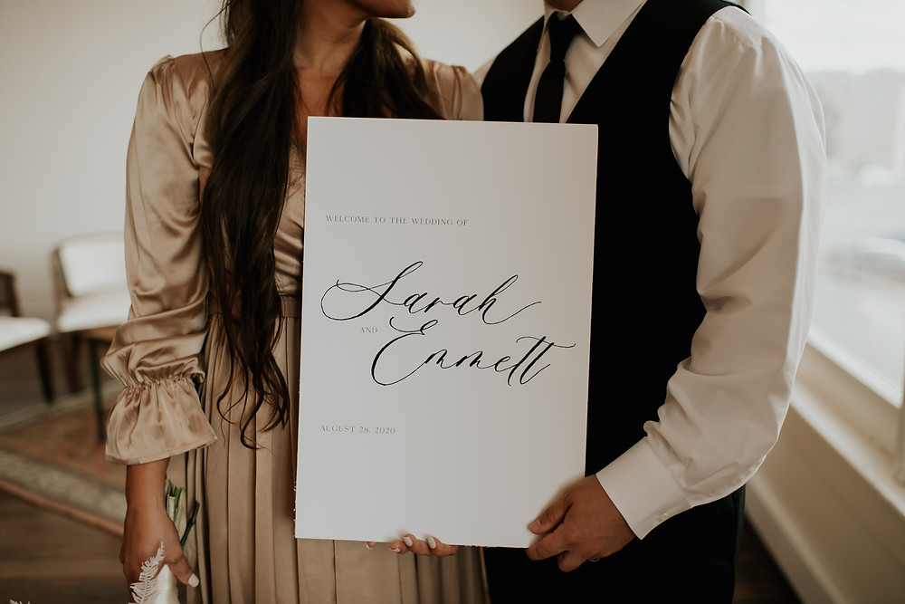 Black and white script font wedding welcome sign