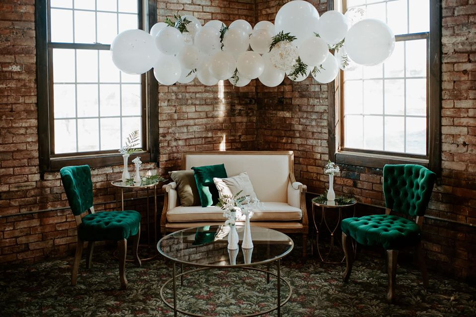 Vintage pieces lounge area: Modern Greenery Baby Shower at Maggie's on the River featured on Pretty Little Vintage Co.