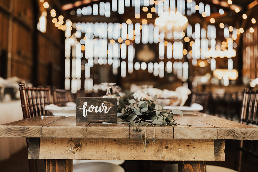 Rustic Farm Table with Wooden Wedding Table Number: Charming Bohemian Gilbertsville Farmhouse Wedding captured by Rachel Liz Photography featured on Pretty Little Vintage Co