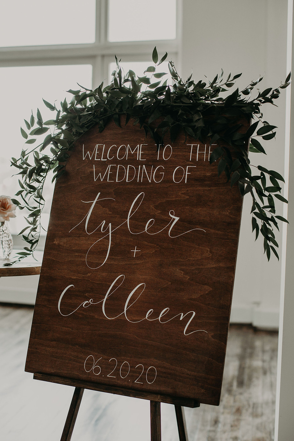 Wood wedding welcome sign with greenery: Summer Small Wedding at The Lincoln Loft
