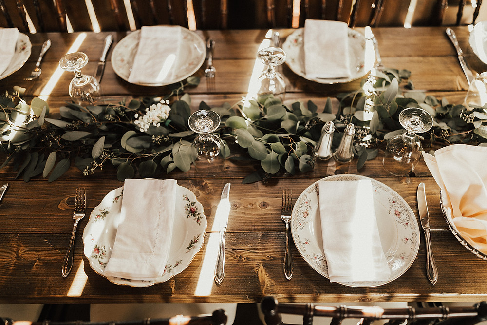 Rustic Farm Table with Vintage China Wedding Tablescape: Charming Bohemian Gilbertsville Farmhouse Wedding captured by Rachel Liz Photography featured on Pretty Little Vintage Co