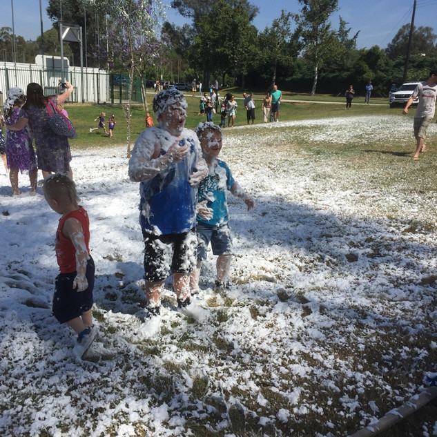 Playing in Dr. Bronner'ss foam