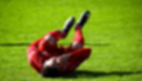 How do sports injury occur? Soccor player is injuried on field