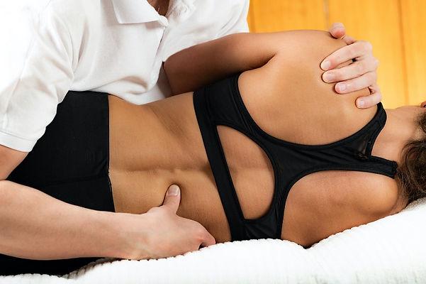 chiropractor adjusting female patient