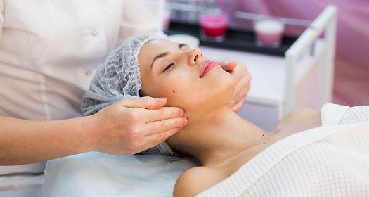 young-woman-enjoying-facial-at-spa-salon