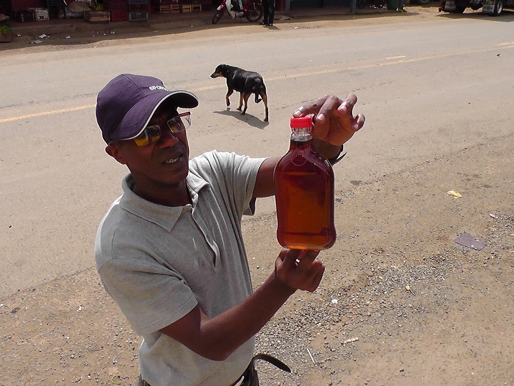 Vic holding bee honey
