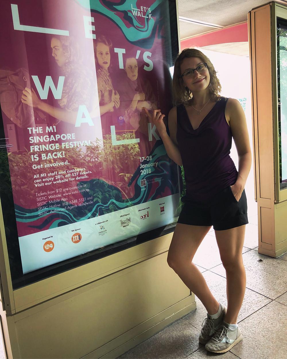 Anna Mazurik next to the team's billboard at the Esplanade bus stop