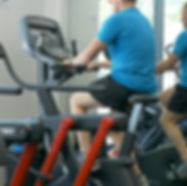 Male Patient on exercise bike as a part