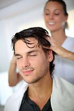 Hairdresser doing head massage to custom