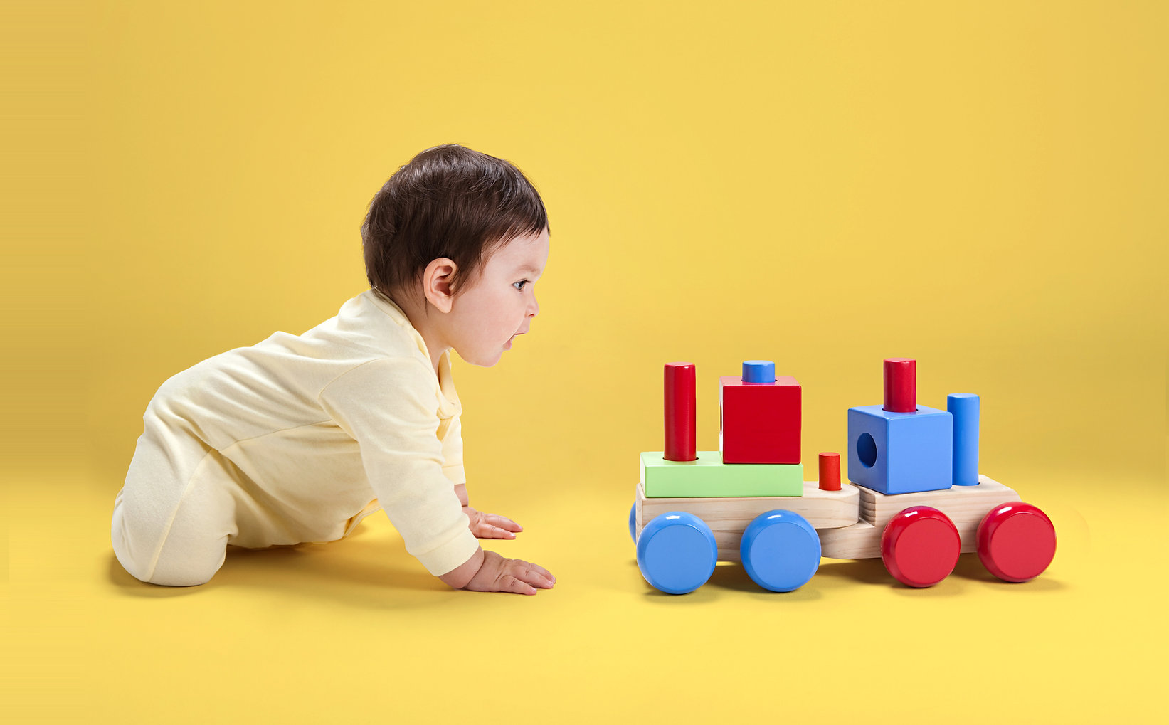 Baby with Wooden Toy