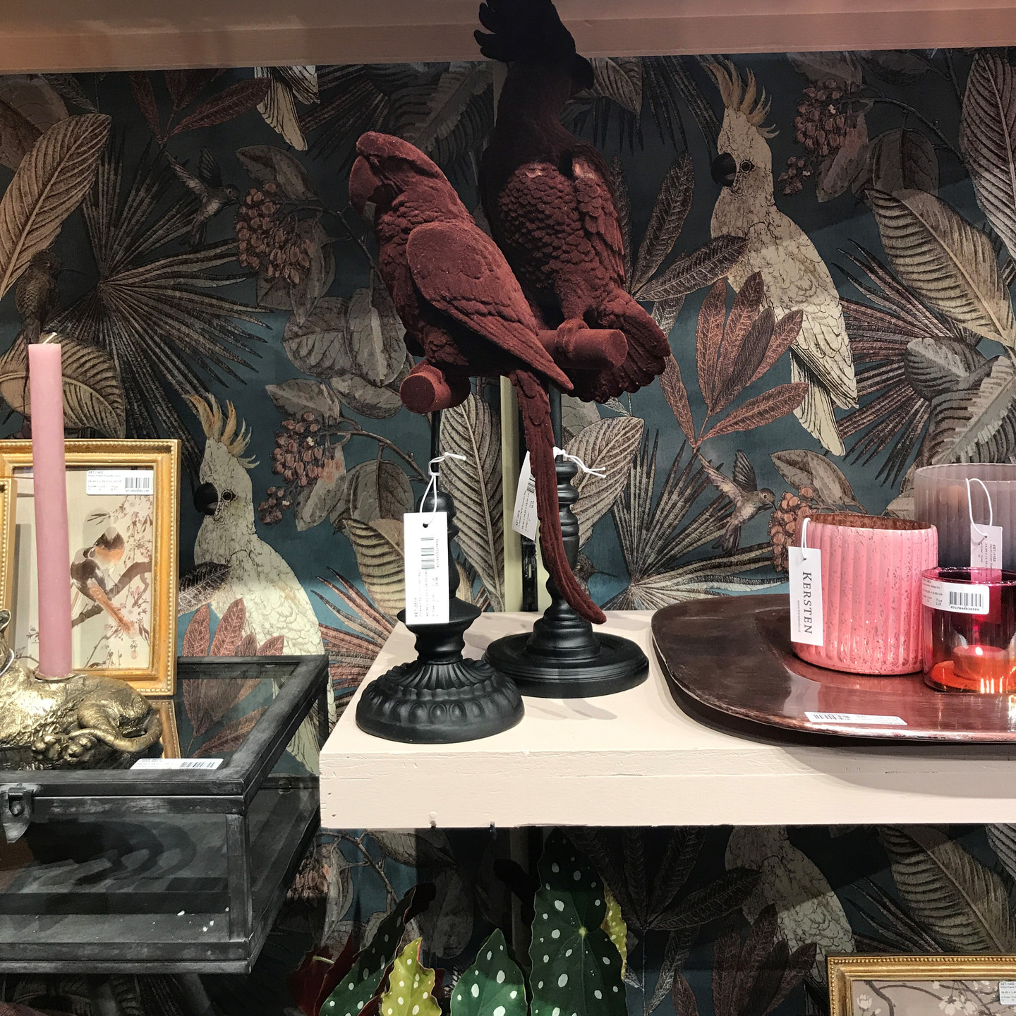 Home Decor Display at Maison & Objet with Tropical Print Wallpaper and Velvet Parrot Statues
