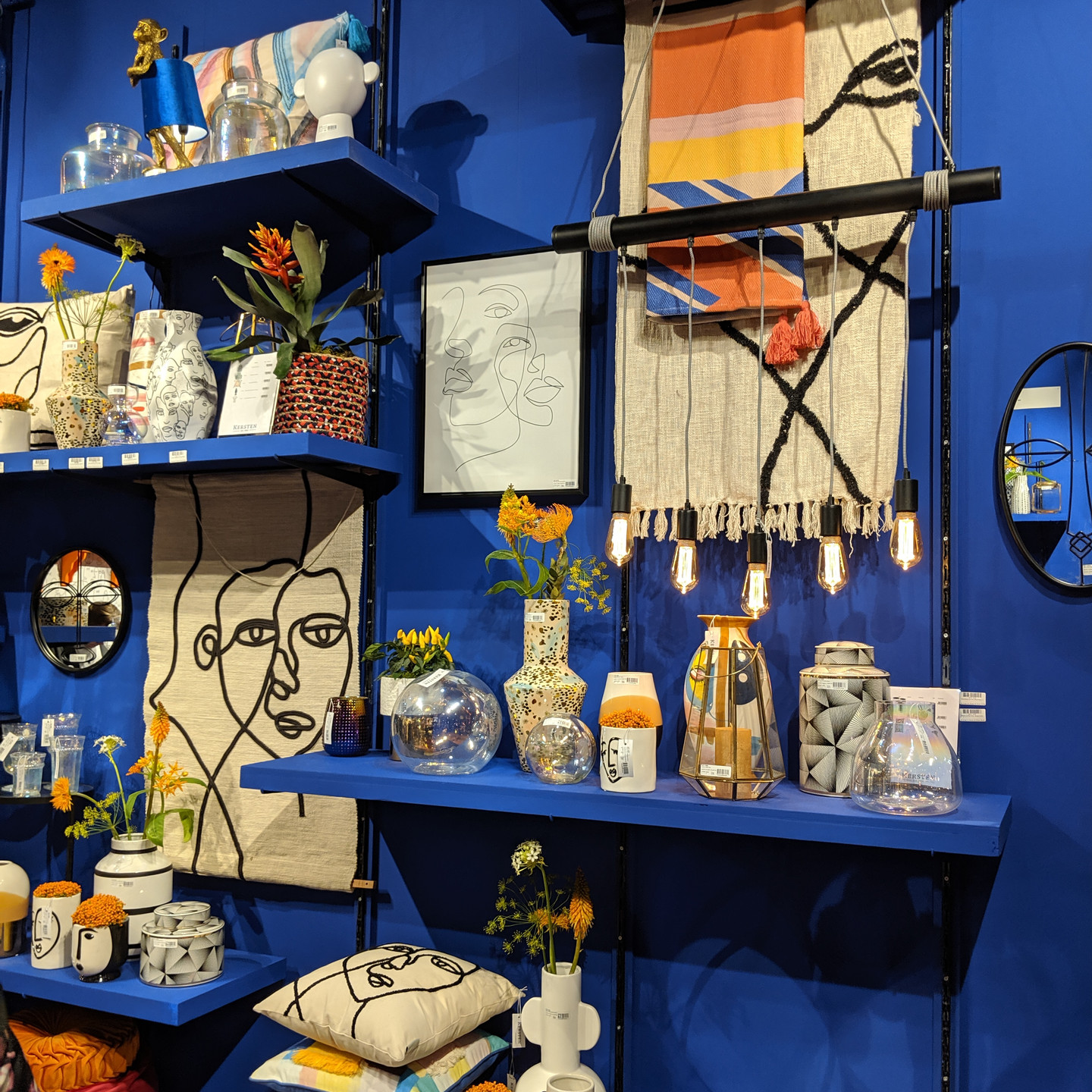 Neutral Home Decor Display on on Bright Blue Wall with Blue Built-In Shelves