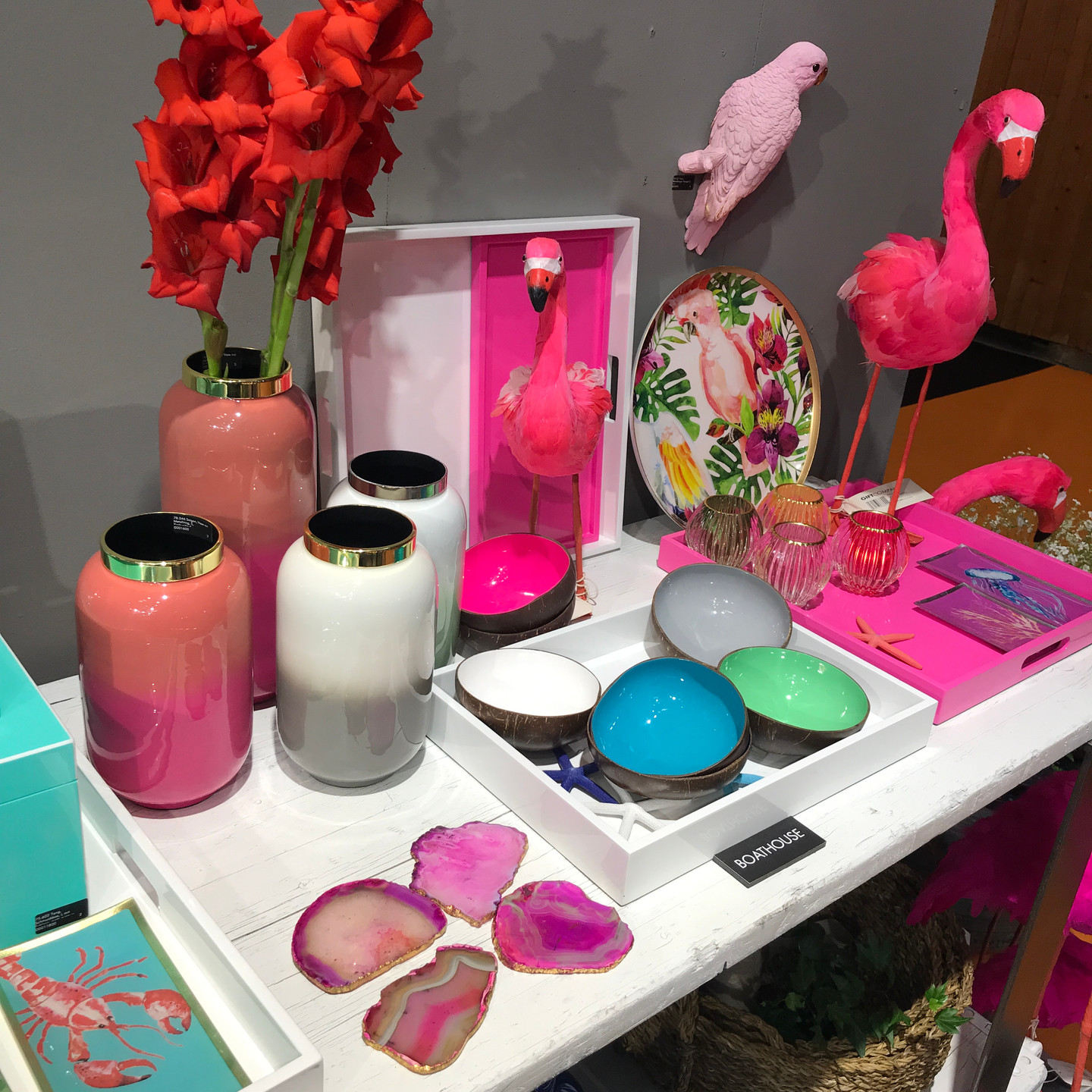Neon Home Accessories Display with Flamingos, Trays, Bowls, and Vases