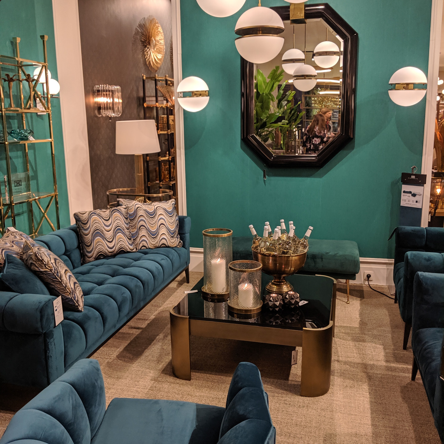 Peacock Blue Living Room with Velvet Sofa, Chairs, & Bench and Brass Accents