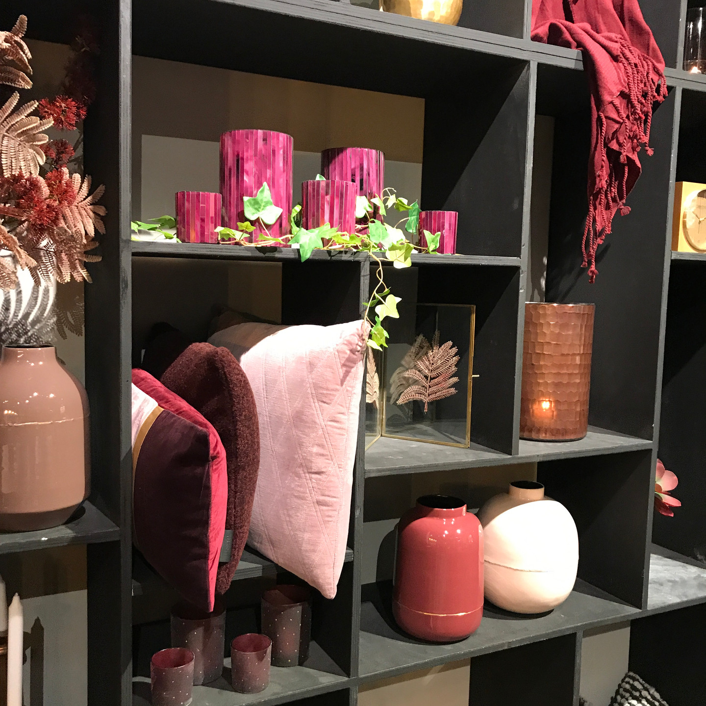 Burgundy and mauve home accessories display wall