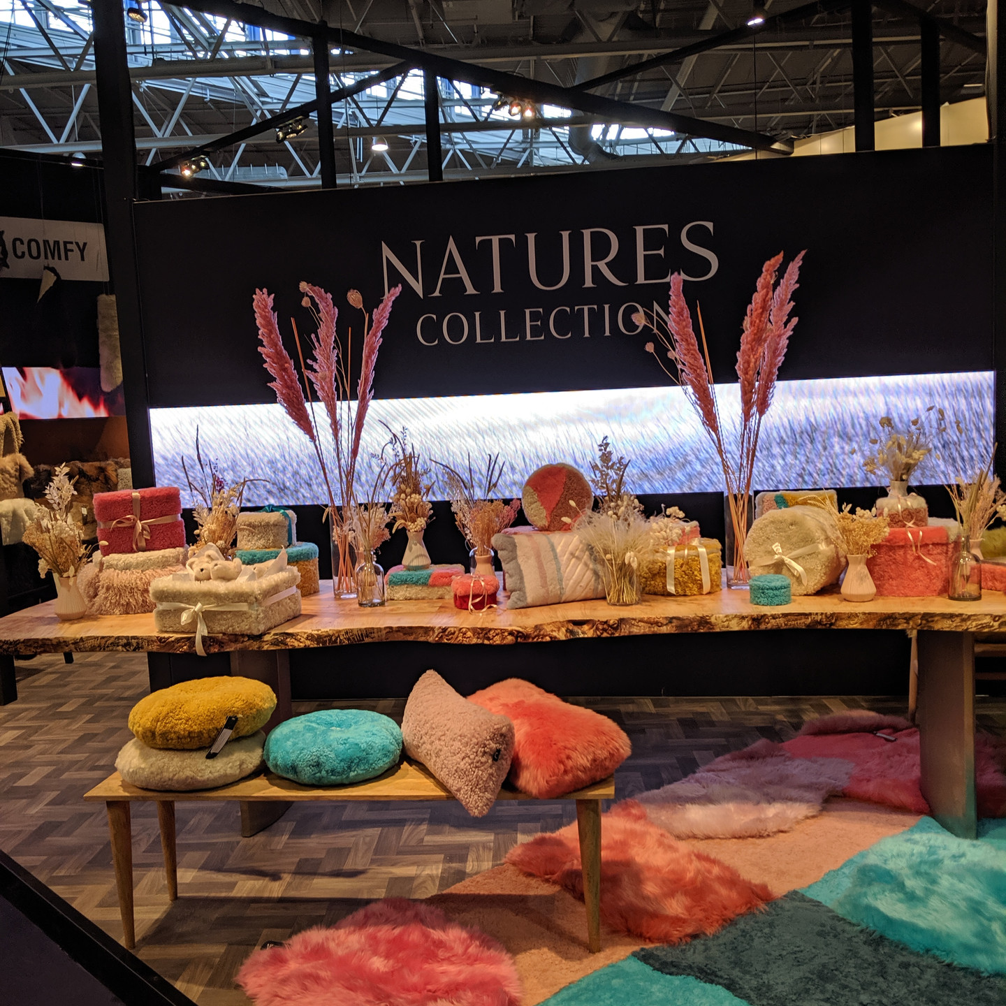 Brightly Colored Display of Faux Fur Throw Pillows and Housewares