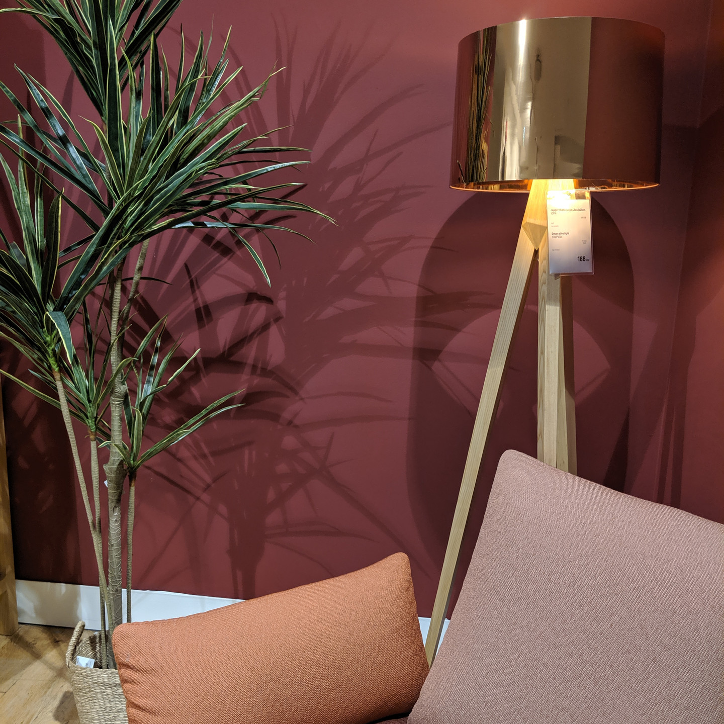 Burgundy Wall with Rose, Blush, and Bordeaux Sofa and Wood & Brass Floor Lamp