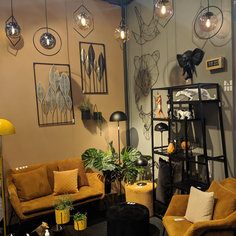 Mustard Velvet Sofa with Black Shelf and Wall Decor