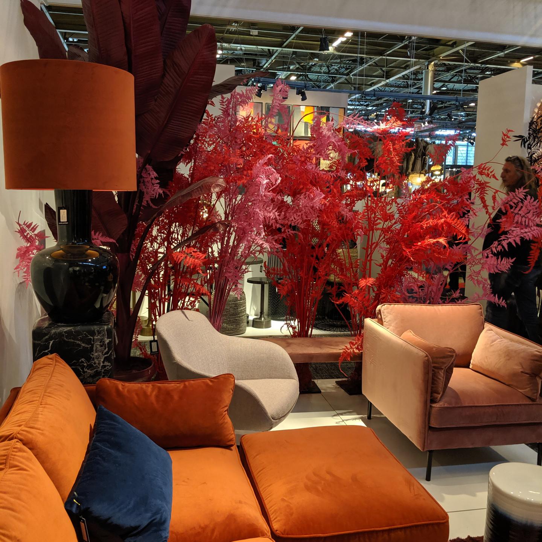 Orange Velvet Sofa with Peach Velvet Chair and Brightly Colored Plants