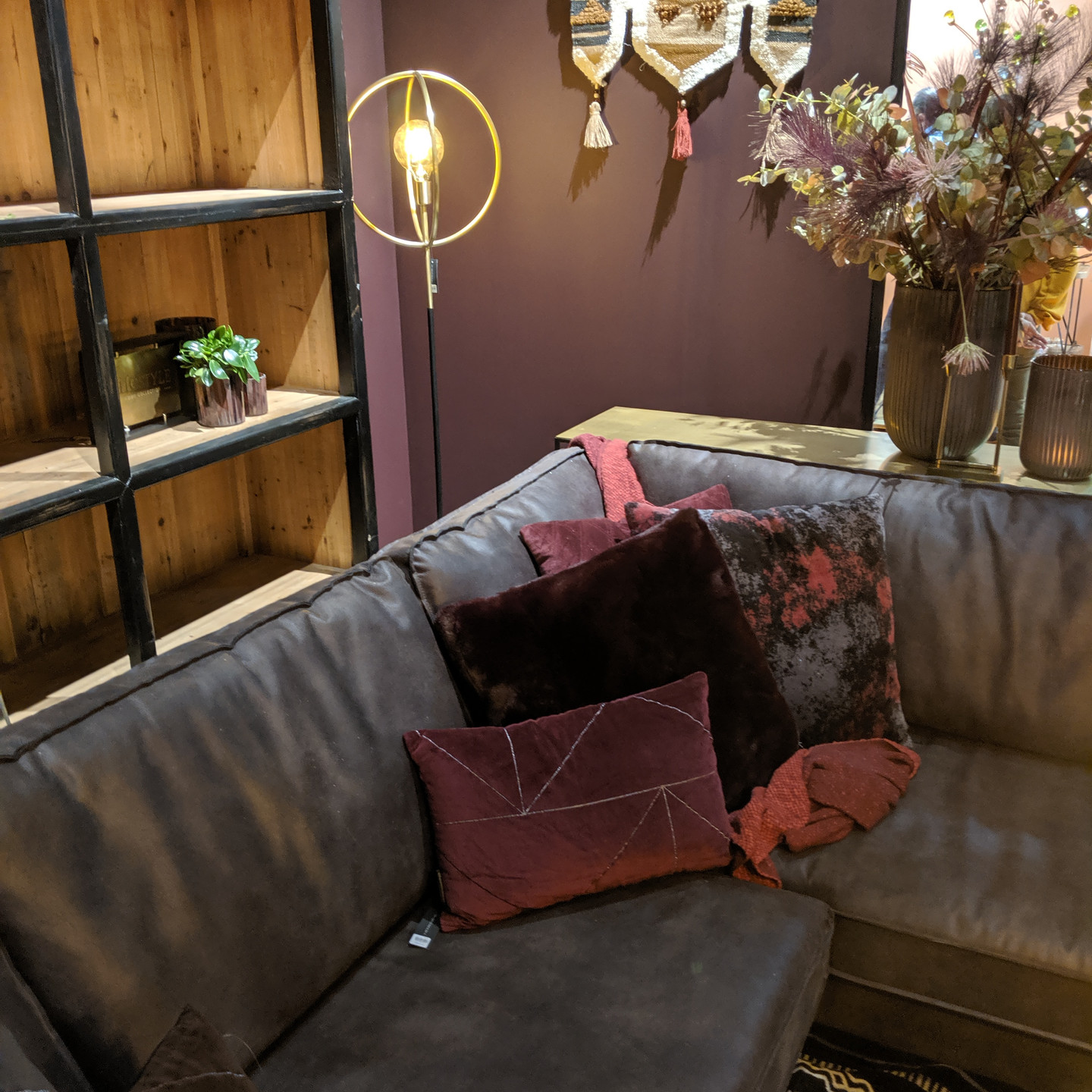 Brown Leather Sofa with Burgundy and Merlot Velvet Pillows