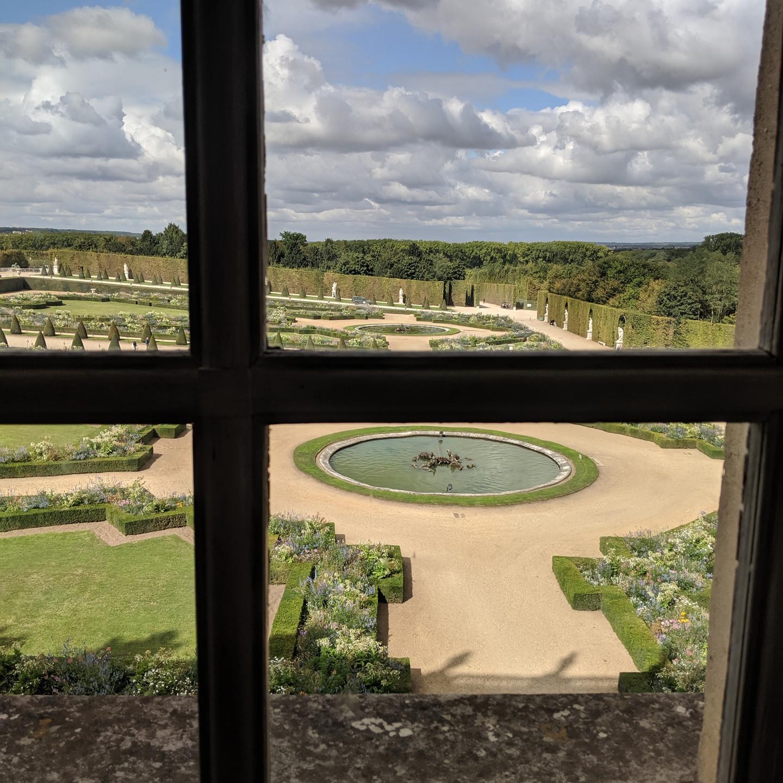 Gardens at Versailles viewed through window panes