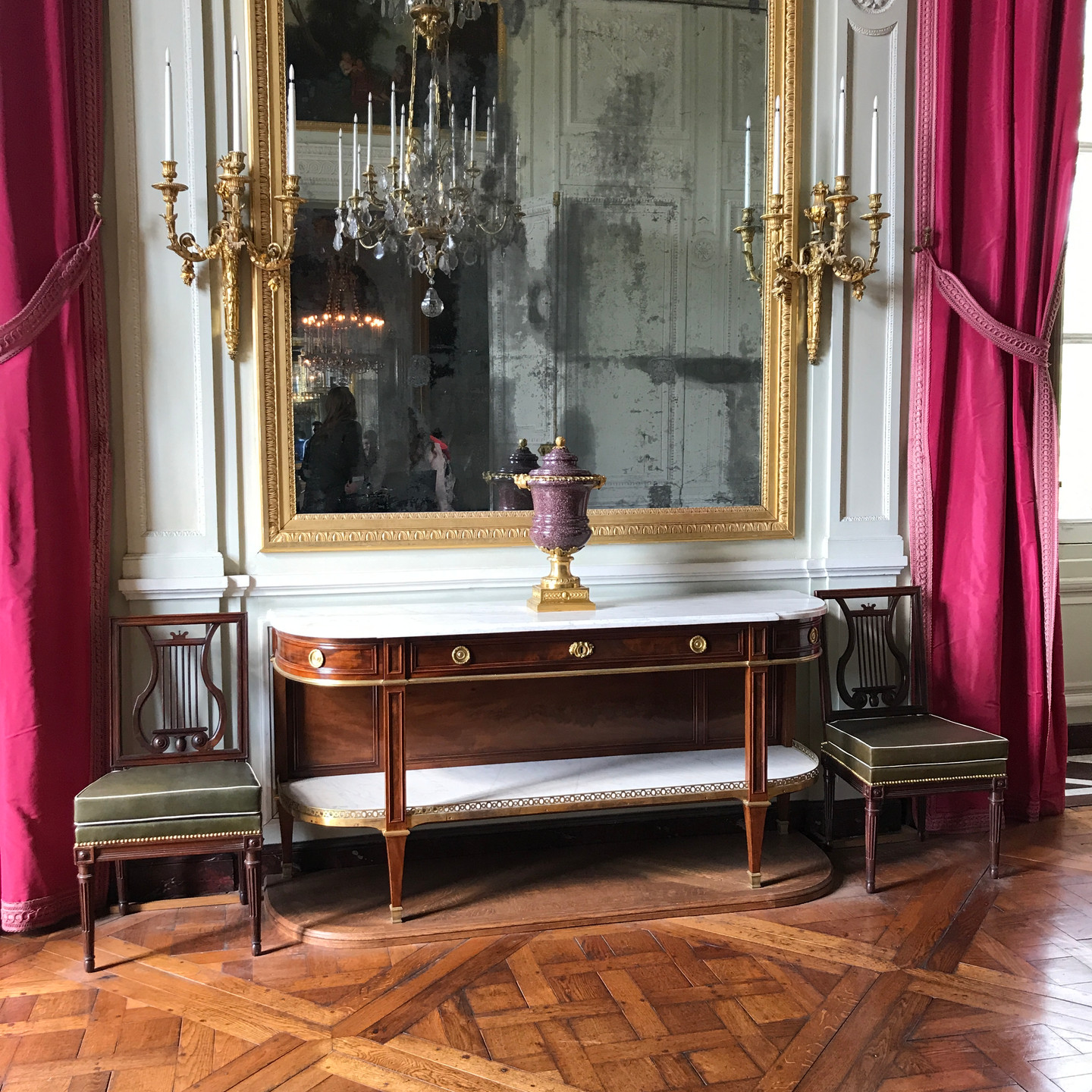 Sideboard and Chairs with Oversized Mirror at Versailles