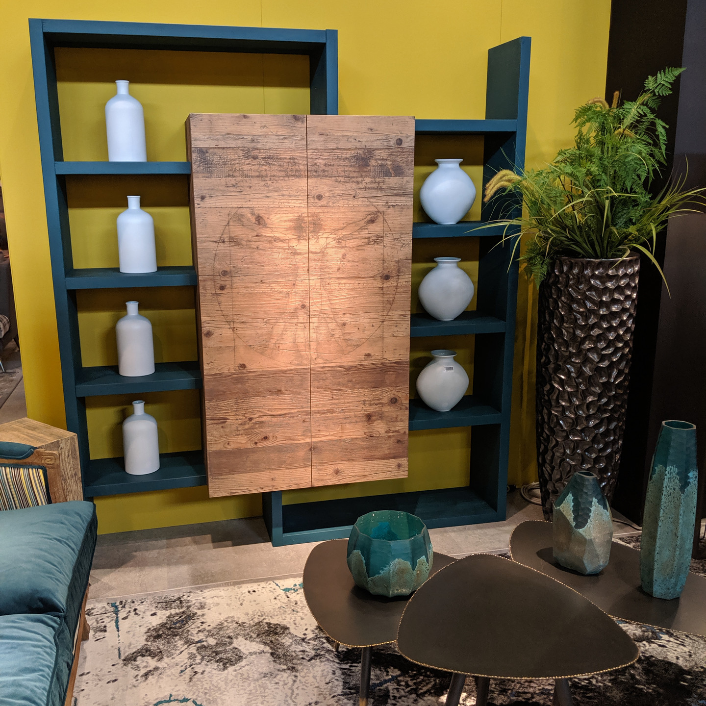 Mustard Yellow Wall with Turquoise and Wood Shelving Unit