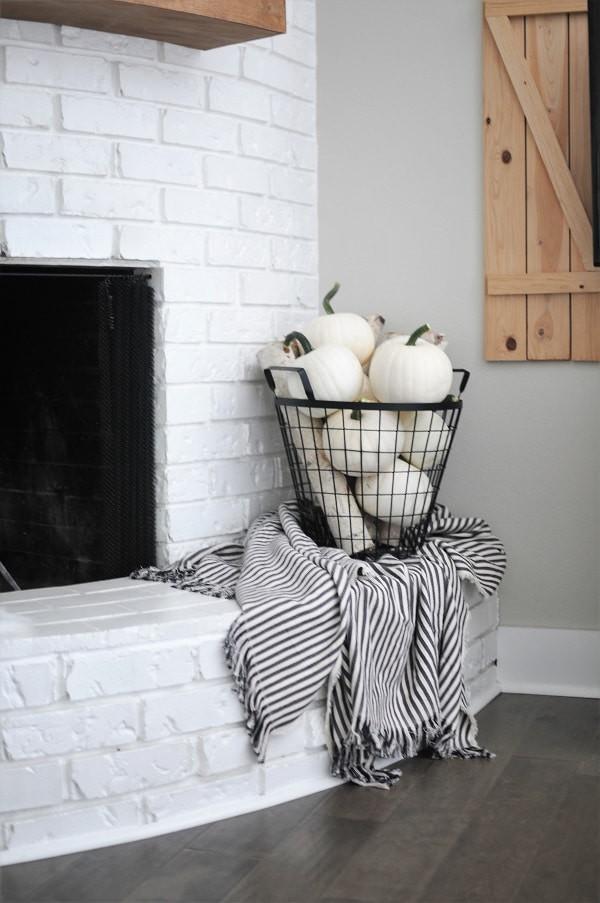 white pumpkin fireplace decor