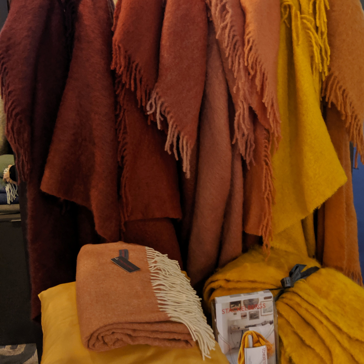 Assorted Wool Throw Blankets in Shades of Red, Orange, and Yellow