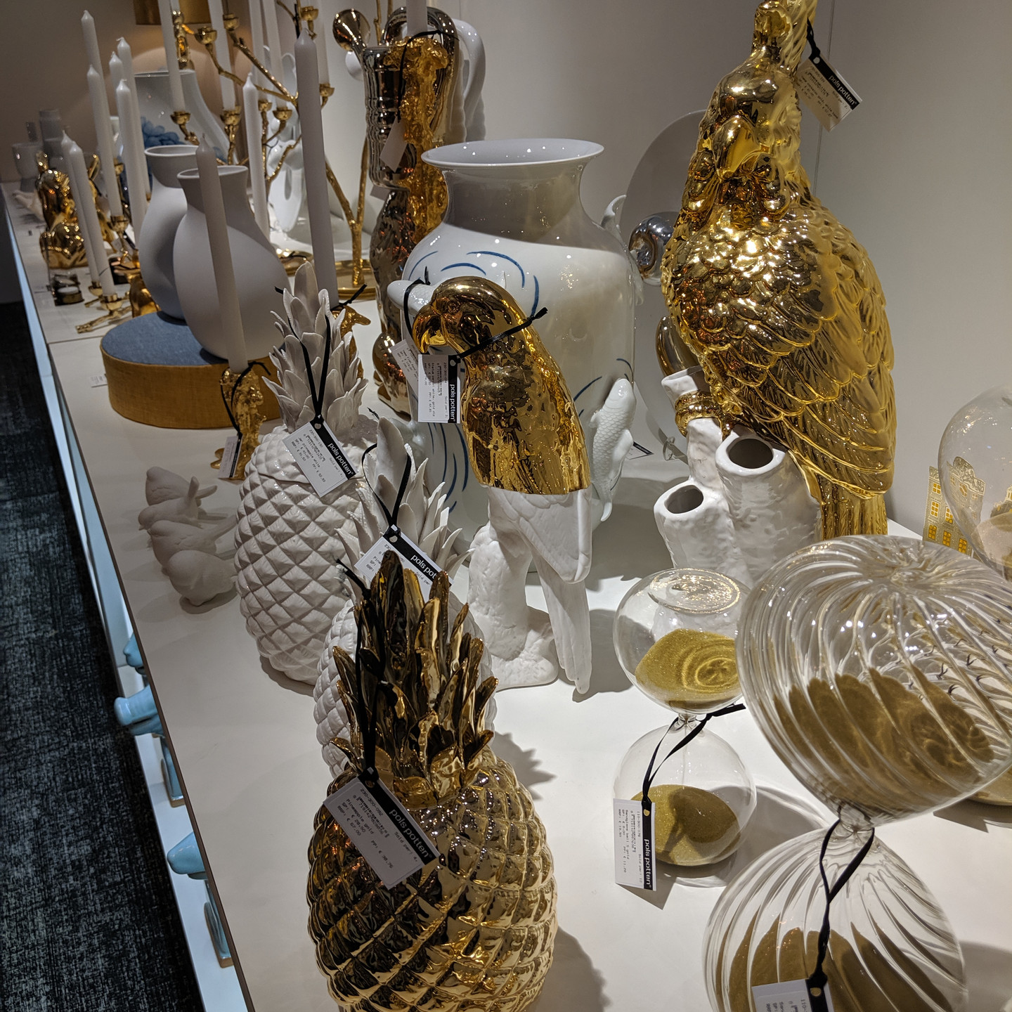 Shelf of white and gold decorative accessories