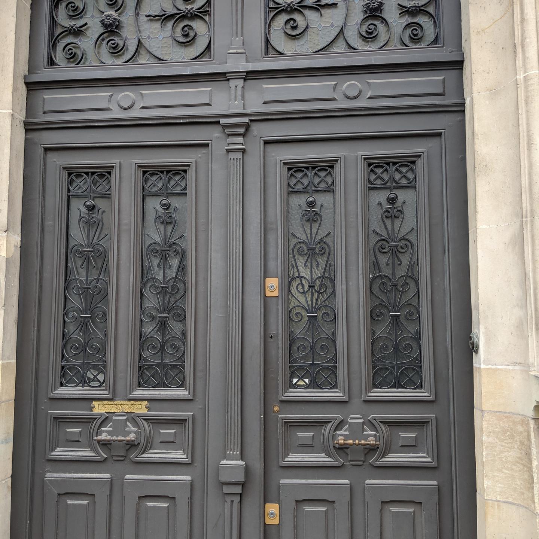 Grey Doors with Wrought Iron Detail in Paris
