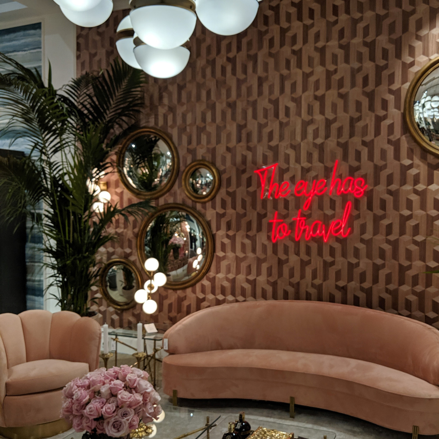 Feminine Blush Velvet Sofa and Chair with Round Wall Mirrors and Neon Wall Sign