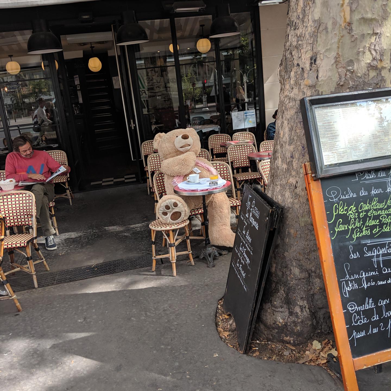 Paris Teddy Bear Enjoying a Cup of Coffee Outside A Cafe
