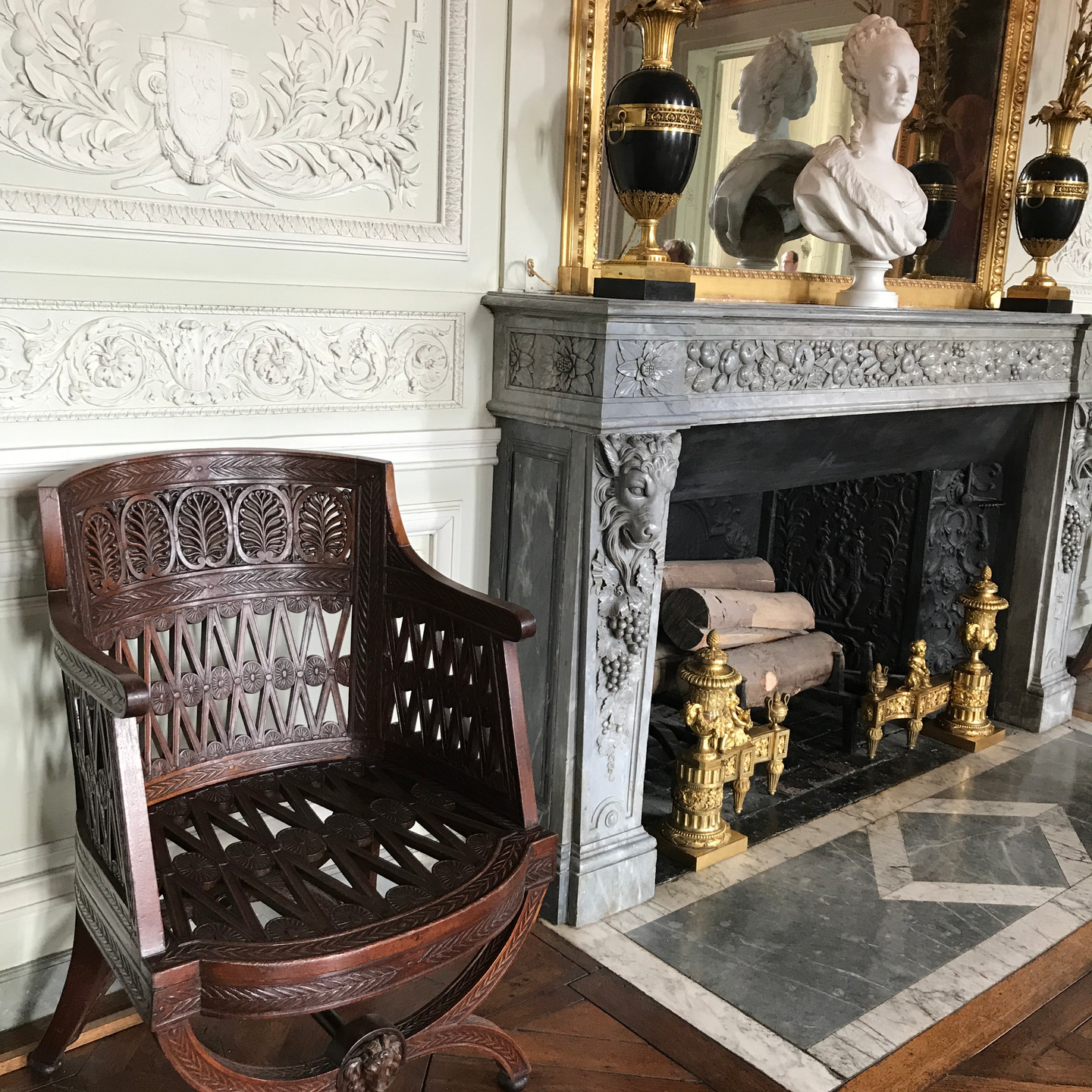 Carved Wooden Armchair next to Fireplace at Versailles