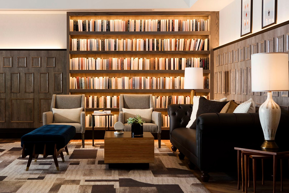 Library at Mason & Rook Hotel in Washington DC with Chesterfield sofa and mid-century modern chairs