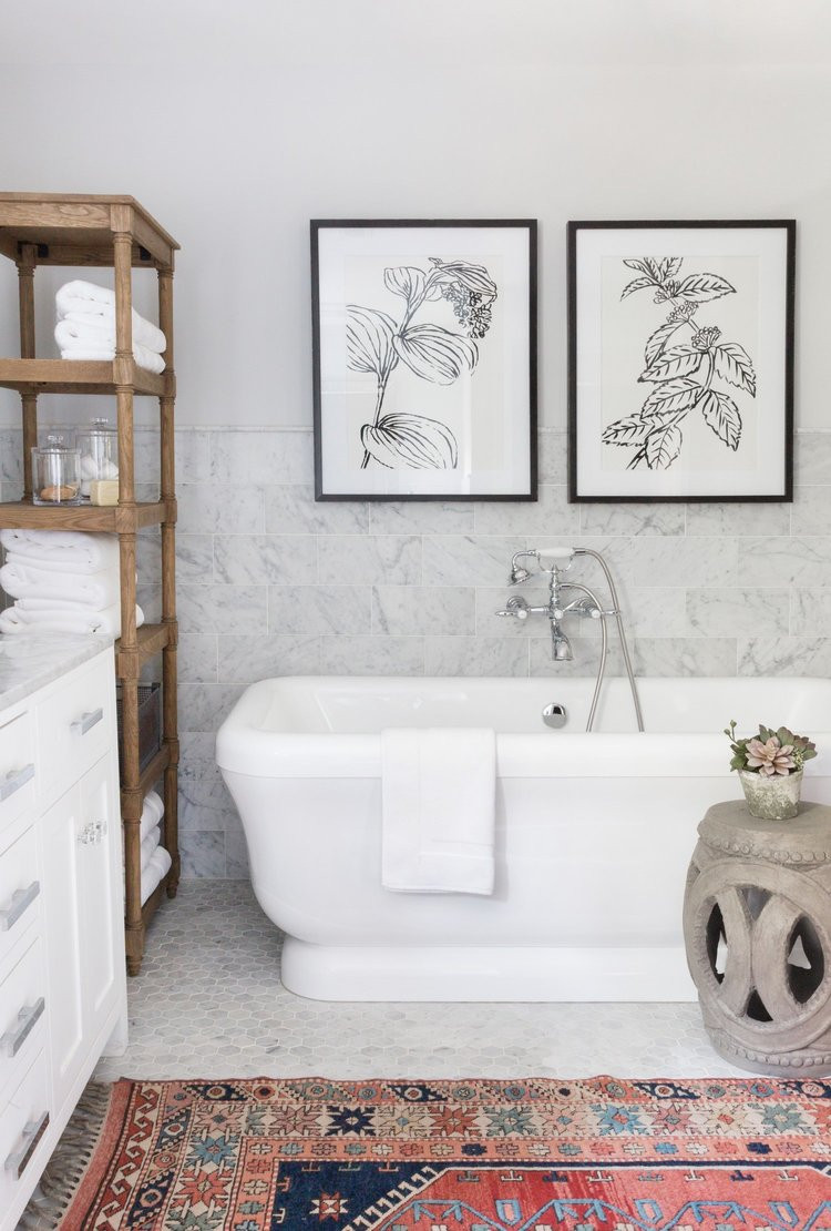 Vintage Inspired White Marble Bathroom with Black and WHite Line Drawn Botanical Prints and Moroccan Rug