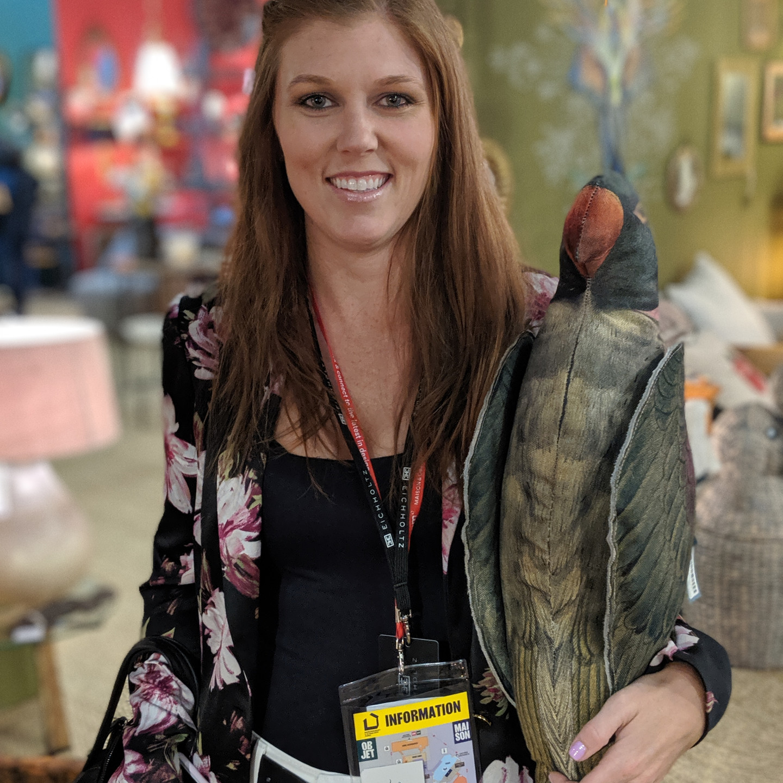 Laura Fox Interior Designer with Stuffed Parrot