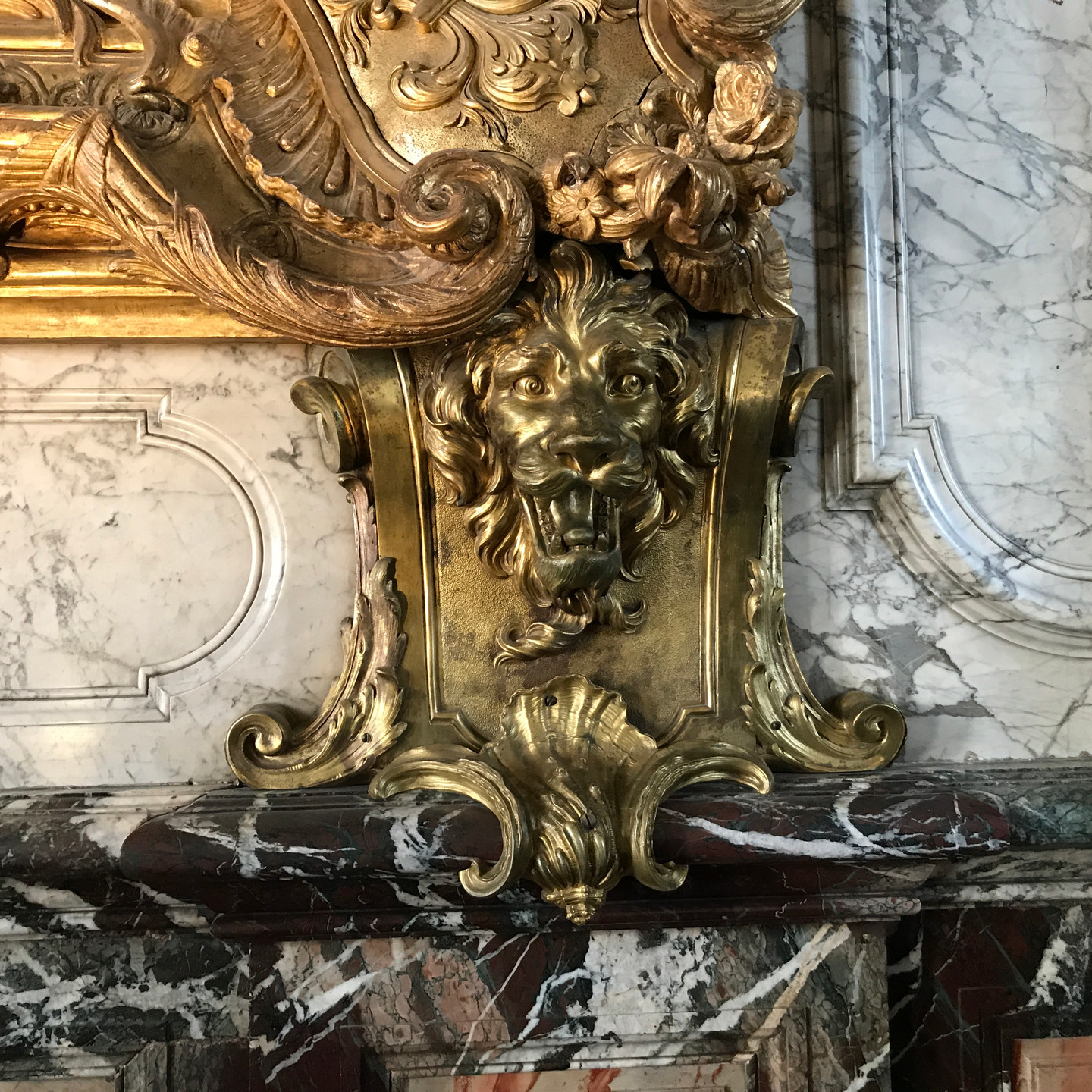 Gilded Lion Fireplace Detail at Versailles