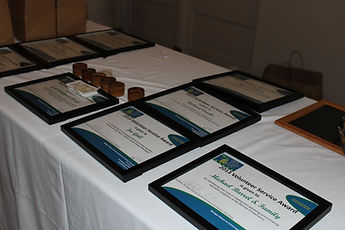 a white table with certificates displayed on it